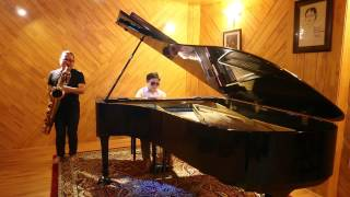 Tran Manh Tuan & Quoc Dat playing Chiec La Cuoi Cung after the recording session at TMT' studio.