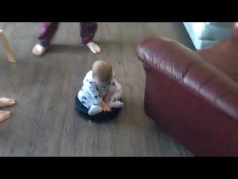 This Roomba-Riding Baby Is The Perfect Way To Start 2014