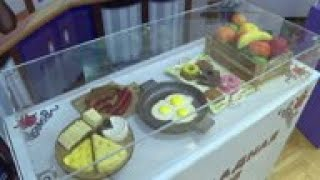 Chocolate Teapots, Sausages And Pianos On Display At Exhibition