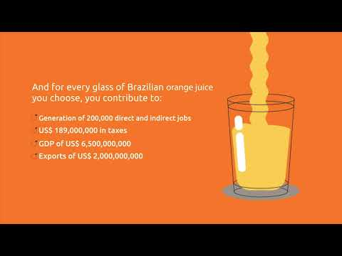 Behind a glass of orange juice