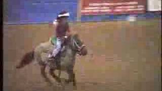 Cute little Girl Running Barrels on a little horse