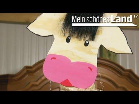 Dekoschild in Tierform: eine Kuh mit Kuhglocke!