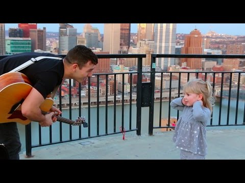Playing for dancing girl on top of Pittsburgh.
