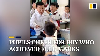 Pupils cheer for boy who achieved full marks in China