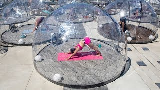 video: Watch: Yoga class uses see-through domes to keep students safe