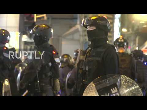 Hong Kong: Protesters hurl firebombs as police fire rubber bullets at banned rally