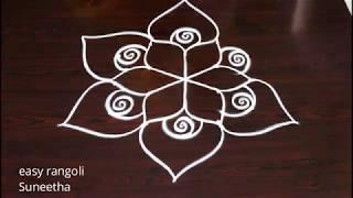 How to draw creative rangoli kolam arts  ||  latest muggulu   easy rangoli by Suneetha