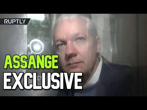 EXCLUSIVE: Julian Assange recorded inside prison van during transportation