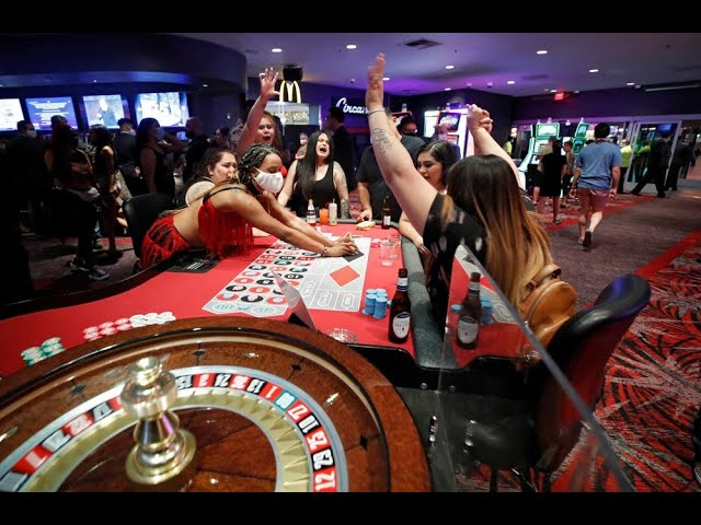 Las Vegas rolls the dice, reopens 23 casinos