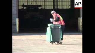 WRAP  Singer Boy George begins  community service, cleans up yard