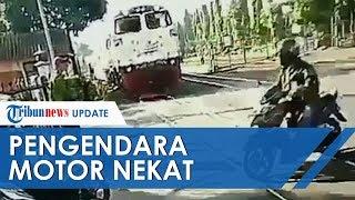 Viral Pengendara Motor yang Hampir Tertabrak Kereta karena Nekat Terobos Jalur Perlintasan