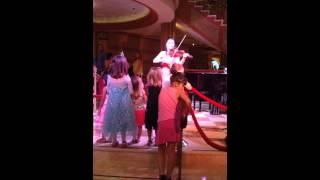 Violinist Irine Gamdzhashvili performing on the disney Dream cruise line