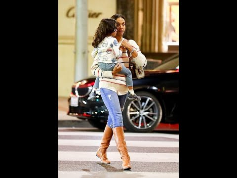 Zoe Saldana stuns in a sweater and bronze boots as she steps out with children and husband