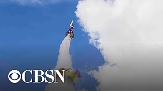 """Daredevil and Flat Earth theorist Michael """"Mad Mike"""" Hughes died Saturday in a rocket crash. Hughes, 64, wanted to prove the Flat Earth theory by taking photographs of the Earth from a homemade rocket. CBSN Los Angeles reports."""