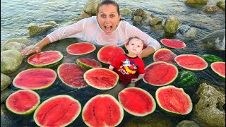 Mommy and Baby Having Fun in WATERMELON POOL