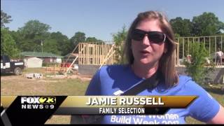 Women help build a home for a local family