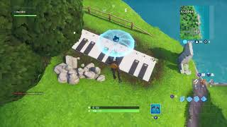 Fortnite Visit Oversized Phone Big Piano and Dancing Fish Trophy