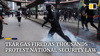Tear gas fired as thousands protest Beijing's planned national security law for Hong Kong