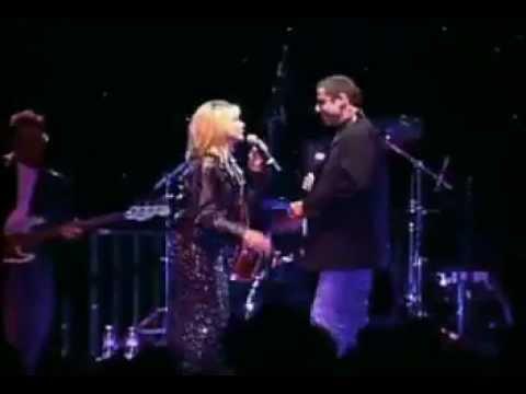 "Olivia Newton-John & John Travolta live ""You re the One That I Want""."