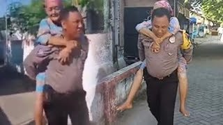 Bripka Purnomo Rela Gendong Lansia Stroke Menuju TPS 01 Babat Lamongan untuk Nyoblos