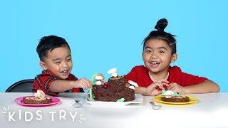 Kids Try Christmas Food from Around the World (Round 3) | Kids Try | HiHo Kids