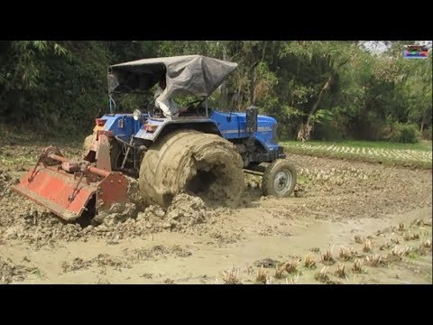 Sonalika Di-47 RX tractor work with Rotavator in heavy mud