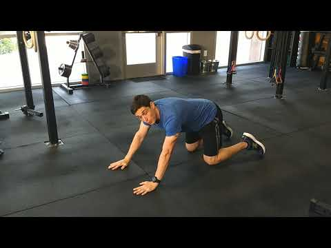 Push-up with alternating arm reach