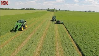 JOHN DEERE Tractors At Work On A Farm Mowing Hay