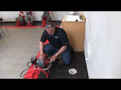 Using the RIDGID K3800 drum machine to clean a sink drain