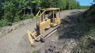 Cutting in driveway drainage with bulldozer