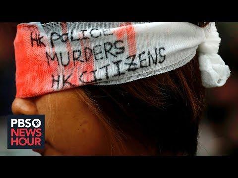 Amid paralyzing Hong Kong demonstrations, China threatens grave consequences