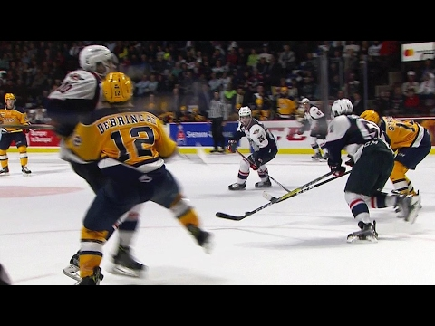 DeBrincat collides with Addison and leaves ice with assistance