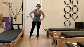 תרגול א- סימטרי לשיווי משקל וחיזוק מקרבים בעמידה עם חישוק פילאטיס