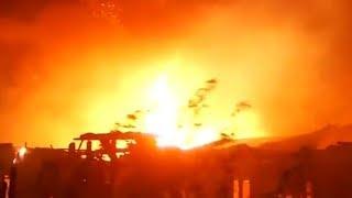 Wildfires sweep through Malibu, California as residents evacuate
