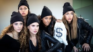 Every person in a heist has a role: driver, hacker, look-out, demolitionist and most importantly…the DJ. Watch Amanda Cerny, Inanna Sarkis, Sofie Dossi, Andrea Russett and I rob a bank and miserably fail. No one is specifically to blame though.   WATCH BEHIND THE SCENES HERE: https://www.youtube.com/watch?v=fD49U9OxbDA  CHECK OUT MY GIRLS: Amanda Cerny:  https://www.youtube.com/user/MissAmandaCerny Inanna Sarkis:  https://www.youtube.com/user/BABY24K Sofie Dossi:  https://www.youtube.com/user/SofieDossi Andrea Russett: https://www.youtube.com/user/GETTOxFABxFOREVER  Subscribe: http://bit.ly/SubLillySingh | MERCH: https://lillysingh.com Watch The Girl Code (ft. Grace Helbig, Harto, Jenna Marbles, Mamrie Hart, Miranda Sings)! https://youtube.com/watch?v=6IJ4pvVYuLM   If you want to add translations, click the gear icon and go to Subtitles/CC then to Add subtitles or CC!   Follow Paramjeet: Instagram: https://instagram.com/iiparamjeetii/ Twitter: https://twitter.com/iiparamjeetii/   Follow Manjeet: Instagram: https://instagram.com/iimanjeetii/ Twitter: https://twitter.com/iimanjeetii/   Get HOW TO BE A BAWSE: https://lillysinghbook.com   Follow Lilly Singh: Facebook: https://facebook.com/IISuperwomanII/ Instagram: https://instagram.com/iisuperwomanii/ Twitter: https://twitter.com/iisuperwomanii Lilly Singh Vlogs: https://youtube.com/user/SuperwomanVlogs Official Website: http://lillysingh.com/   Watch More Lilly Singh: Types Of People: https://youtube.com/watch?v=eR_nzGqYXNw&list=PLuBXqtS2jaLMu81JnF6AOnRHzG6Csbd6y My Parents: https://youtube.com/watch?v=EPHMXbZml_s&list=PLuBXqtS2jaLOGQynSYvxaqUgvNl7Ovz8x Skits: https://youtube.com/watch?v=jyxi0rfEDnE&list=PLuBXqtS2jaLMhu9PU0tAaHbnqloWibwl0 The Super Rants: https://youtube.com/watch?v=KYadw8gNOok&list=PLuBXqtS2jaLPopv899QwFphiirmD_XWdq Latest Uploads: https://youtube.com/user/IISuperwomanII/videos?view=0&sort=dd&shelf_id=2   Thanks for watching and don't forget to keep smiling. You're worth it! xoxo