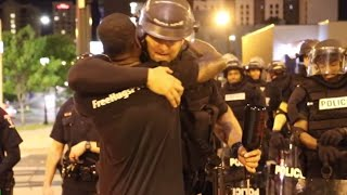 Man gives free hugs to riot police & protesters in Charlotte (RAW) - Video Youtube