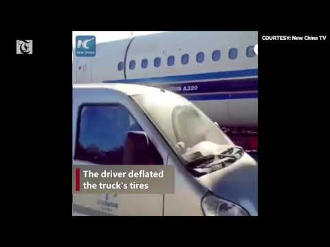 Airplane stuck under footbridge, removed by witty driver