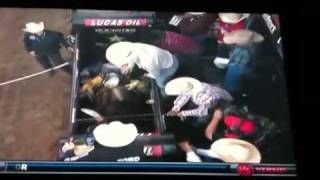 Guy throws bull back in the chute! DANG that's a cowboy!