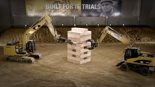 Watch five Cat machines, including excavators, against a mountain of massive JENGA® blocks!