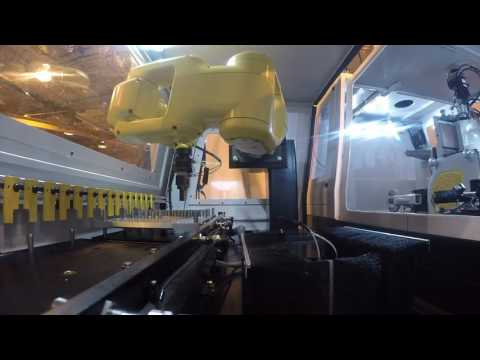 Robotically Loading a Royal Master TG-12x4 Centerless Grinder