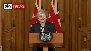 Defiant Theresa May says back me or