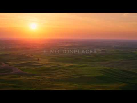 Green hills at sunset. Timelapse.