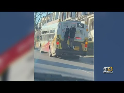 men-hitching-a-ride-on-the-back-of-a-baltimore-bus-caught-on-camera