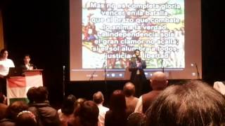 An Indian Singing Colombian national anthem.