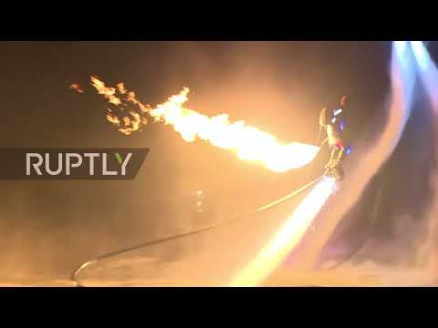 Fearless flyboarders reach for the stars over Volga River