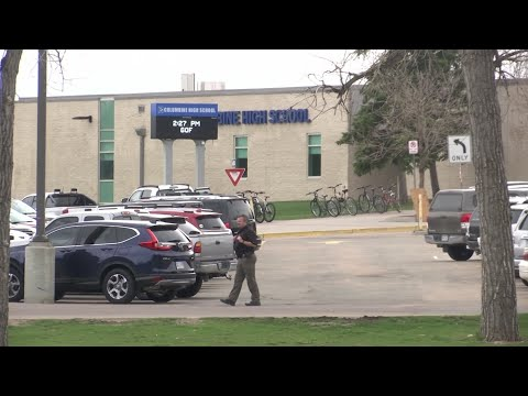 Authorities were looking for an 18-year-old woman suspected of making threats against Columbine High School, just days before the 20th anniversary of a mass shooting. The information prompted a lockdown. (April 16)