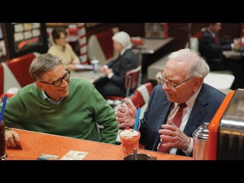 Together, these two men have donated almost $100 billion. Here they are at a candy store.