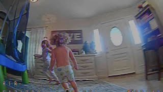 Old FPV video 11/14 Tinyhawk 2 fun chasing the kids around the house and flying through gaps