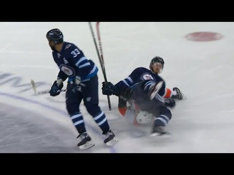 Jets' Byfuglien with a huge hit on Flyers' Weal, takes out his own player by accident