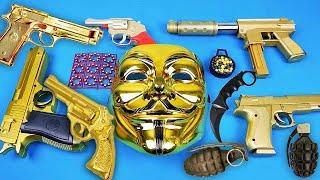 V for Vendetta Maskesi ve Oyuncak Boncuk Atan Altın Silahlar